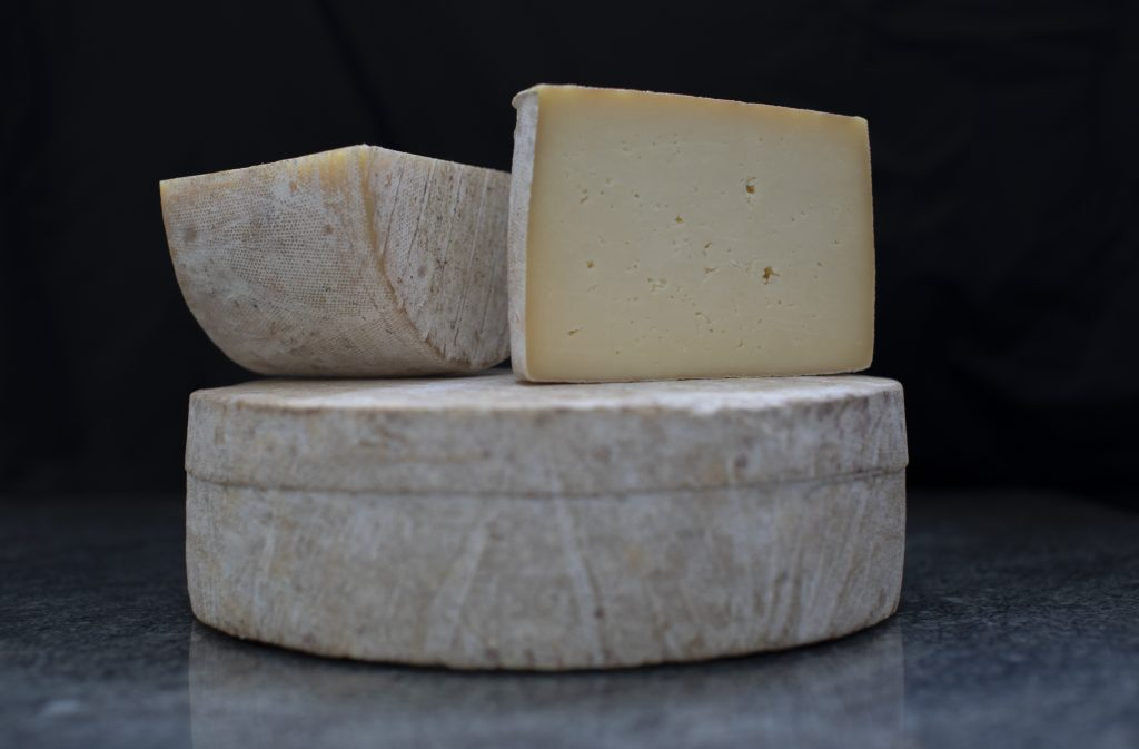 Naked Yarg - a whole Stithians cheese (made to a Yarg recipe but without the nettles) cut in two